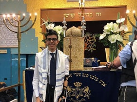Ruben Golran, a Milanese bar mitzvah boy, upon putting on tefillin for the first time.