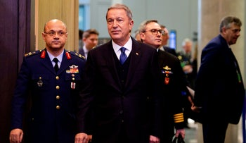 Turkish Defense Minister Hulusi Akar, center, arrives for a meeting of the North Atlantic Council at NATO headquarters in Brussels, February 12, 2020.