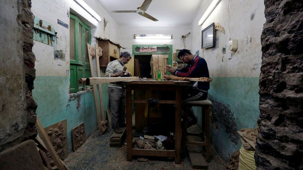 Egyptian craftsmen handle wood parts for furniture at the workshop iin the city of Damietta, Egypt January 14, 2020.