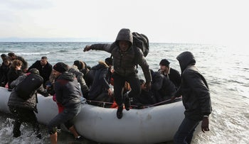 Migrants from Syria, Iraq and sub-saharan African countries arrive on a dinghy near the city of Mytilene, Greece, March 1, 2020.