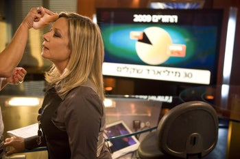 Miki Haimovich getting made up during Channel 10's Election Night coverage in February 2009.