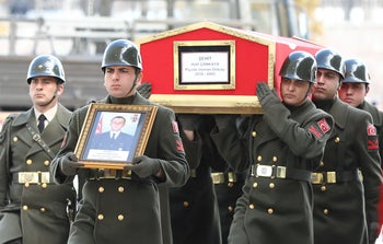 Turkish soldiers carry the coffin of Turkish soldier Halil Cankaya, who was killed in an airstrike in the Syrian town of Idlib, during the funeral ceremony in Ankara, Turkey, on March 1, 2020.