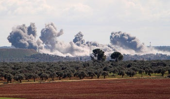 Smoke billows following reported Russian air strikes in northwestern Syria on March 1, 2020.