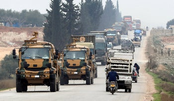 A Turkish military convoy moves in the east of Idlib, Syria, February 28, 2020.