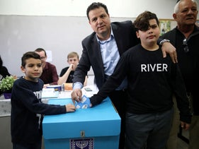 Leader of Joint List party, Ayman Odeh casts his ballot together with his sons at a polling station as Israelis vote in a national election in Haifa, Israel, March 2, 2020.