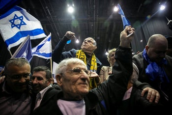 Likud supporters celebrate their party's victory after exit polls show a clear lead in Israel's 2020 election, March 2, 2020.