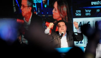 Joint List leader Ayman Odeh rejoicing on election night at the Arab alliance's headquarters in northern Israel, March 2, 2020.