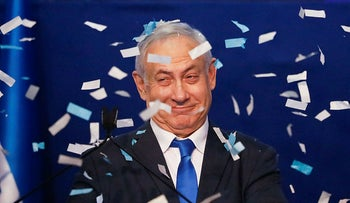 Israeli Prime Minister Benjamin Netanyahu smiles after first exit poll results for the Israeli elections at his party's headquarters in Tel Aviv, Israel, February 2, 2020.
