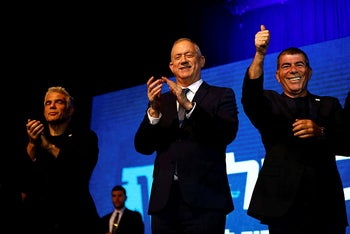 Benny Gantz stands next to Kahol Lavan co-leaders Yair Lapid and Gaby Ashkenazi at the party's headquarters in Tel Aviv, Israel March 3, 2020.