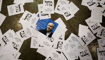 Prime Minister Benjamin Netanyahu's Likud party election ballots are seen on the floor following Netanyahu's address to supporters at the party headquarters in Tel Aviv, Israel March 3, 2020.