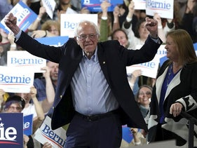 Democratic presidential hopeful Vermont Senator Bernie Sanders accompagnied by his wife Jane O'Meara Sanders arrives during a 2020 Super Tuesday Rally at the Champlain Valley Expo in Essex Junction, Vermont March 3, 2020