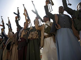 Houthi rebel fighters chant slogans as they hold their weapons during a gathering aimed at mobilizing more fighters for the Iranian-backed Houthi movement, in Sanaa, Yemen, Thursday, Feb. 20, 2020