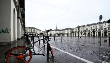 A bicycle parked in Vittorio Veneto square is seen in Turin usually full of tourists as a coronavirus outbreak continues to grow in Italy, in Turin, Italy, March 2, 2020