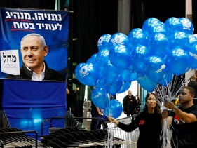 Laborers prepares balloons at the Likud party's electoral campaign headquarters in the coastal city of Tel Aviv on March 2, 2020.