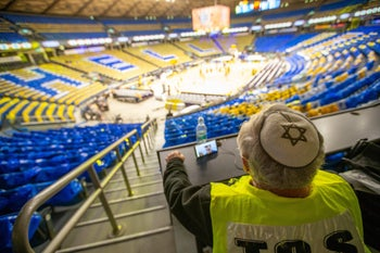 A security guard at Maccabi Tel Aviv's Euroleague basketball game against Andolo Zero, which was played behind closed doors on March 4, 2020.