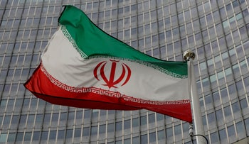 An Iranian flag flutters in front of the International Atomic Energy Agency (IAEA) headquarters in Vienna, Austria September 9, 2019