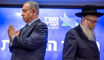 Prime Minister Benjamin Netnayahu and Health Minister Yaakov Litzman at a press conference on the coronavirus in Jerusalem on Wednesday, March 4 2020