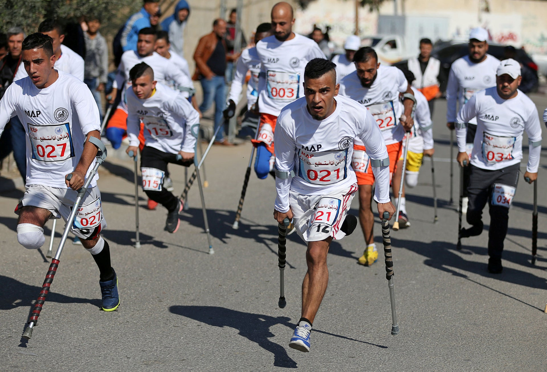 Palestinian amputees compete in a local run racing in the central Gaza Strip December 5, 2019.