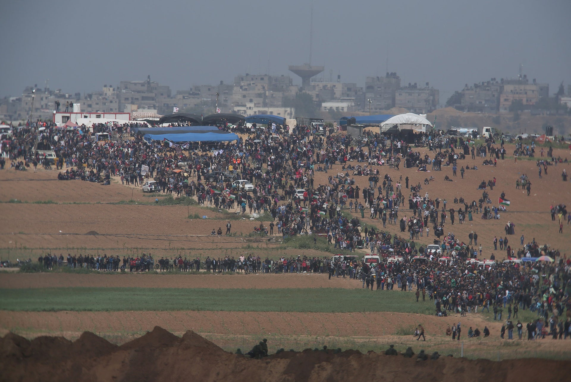View of a March of Return protest in Gaza and Israeli snipers in the foreground, March 30, 2018.
