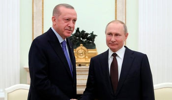 Russian President Vladimir Putin and Turkish President Recep Tayyip Erdogan shake hands during their meeting in the Kremlin, in Moscow, Russia, March 5, 2020.