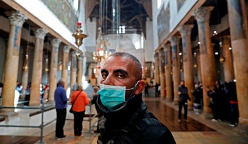 A man wearing a mask as a precaution against coronavirus at the Church of the Nativity in Bethlehem in the West Bank, March 5, 2020.
