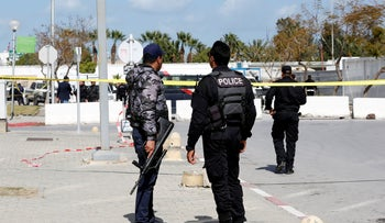 Members of security forces stand guard at the site of an attack near the U.S. embassy in Tunis, Tunisia March 6, 2020