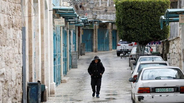 A man walks past closed shops as preventive measures are taken against the coronavirus, in Bethlehem in the Israeli-occupied West Bank March 6, 2020