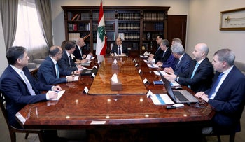 Lebanese President Michel Aoun, center, meets with political and financial officials to discuss the economic situation, at the Presidential Palace in Baabda, March 7, 2020.