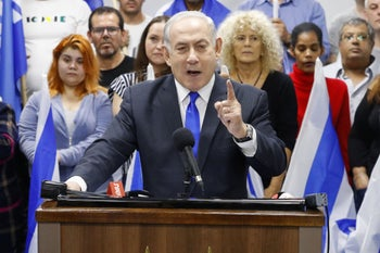 Benjamin Netanyahu delivers a statement in the Israeli central city of Petah Tikva on March 7, 2020.
