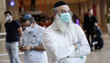 Israelis with masks at Ben-Gurion International Airport, March 5, 2020