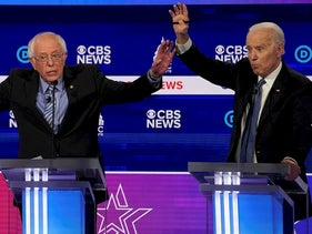 Democratic 2020 U.S. presidential candidates Senator Bernie Sanders and former Vice President Joe Biden brush hands as they have an exchange in the tenth Democratic 2020 presidential debate at the Gaillard Center in Charleston, South Carolina, U.S. February 25, 2020