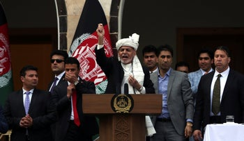 Afghan President Ashraf Ghani, center, speaks after a few rockets were fired during his speech after he was sworn in, Kabul, Afghanistan, Monday, March 9, 2020