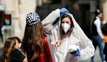 A teenager wears a costume as a reference to the coronavirus during the Jewish holiday of Purim, Jerusalem March 8, 2020.