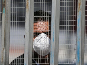 A Palestinian wearing a mask to protect himself from coronavirus exposure at the Rafah Crossing between Gaza and Egypt, March 8, 2020.