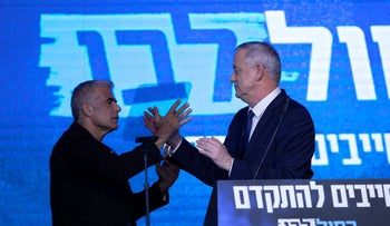 Benny Gantz, right, and Yair Lapid shake hands at the Kahol Lavan headquarters in Tel Aviv, March 3, 2020.