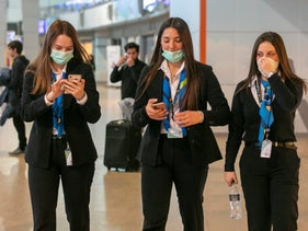 Workers at Ben-Gurion Airport wear protective masks, February 25, 2020.