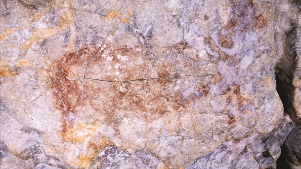 The crude red outline and interior color wash is typical of pre-Magdalenian Paleolithic art, over 20,000 years old