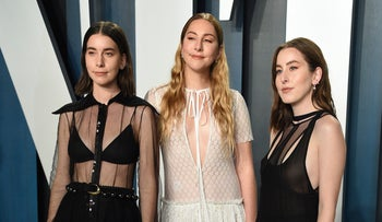 Danielle Haim, from left, Este Haim and Alana Haim arrive at the Vanity Fair Oscar Party in Beverly Hills, California, February 9, 2020.