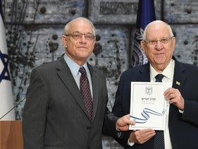 Israeli president Reuven Rivlin receives official election results from Central Elections Committee head Justice Neal Hendel, in Jerusalem March 11 2020