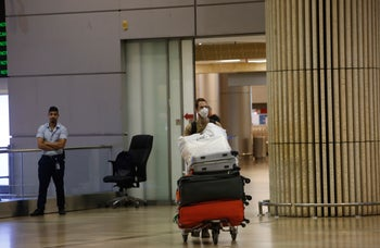 A man arriving at the arrivals hall at Ben-Gurion Airport, Tel Aviv, March 2020.