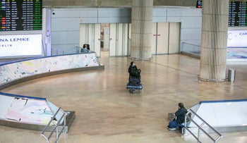 A passenger entering the desolate Terminal 3 at the Ben-Gurion International Airport, Israel, March 12, 2020