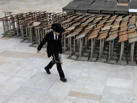 An ultra-Orthodox Jewish man walking past a nearly deserted Western Wall in Jerusalem on March 12.