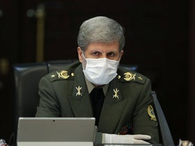 Iran's Defense Minister Brigadier General Amir Hatami wearing a protective mask and gloves as means of protection against the coronavirus COVID-19, March 11, 2020.