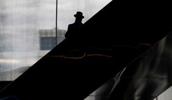 An Orthodox Jew rides an escalator at the MetLife Stadium in East Rutherford, New Jersey, U.S., January 1, 2020.