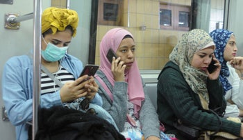 A woman wearing a protective mask against the coronavirus in the Cairo Metro, March 10, 2020.