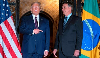 U.S. President Donald Trump speaks with Brazilian President Jair Bolsonaro during a dinner at Mar-a-Lago in Palm Beach, Florida, on March 7, 2020.