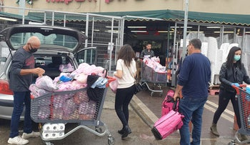 Israelis go shopping anticipating possible restrictions of freedom of movement or limitations in the availability of supplies because of coronavirus, on Friday, March 13, 2020.