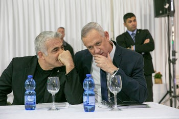 Kahol Lavan leaders Yair Lapid (L) and Benny Gantz (R) at an event in Ramat Gan, March 15, 2020.