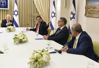 President Reuven Rivlin (L) meets with the Joint List's Ayman Odeh (Hadash), Mtanes Shehadeh (Balad), Ahmad Tibi (Ta'al) during consultations to name the next Israeli prime minister, March 15, 2020.