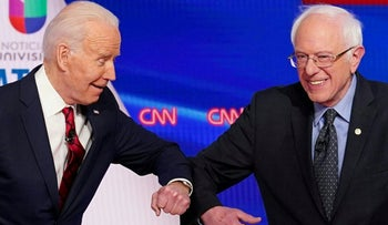 Democratic presidential hopefuls former U.S. vice president Joe Biden and Senator Bernie Sanders greet each other with a safe elbow bump before the start of the 11th Democratic Party 2020.